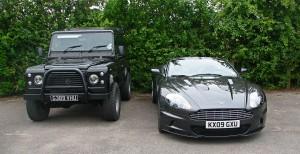 Two British classics: A Range Rover Defender and the Aston Martin DBS Volante