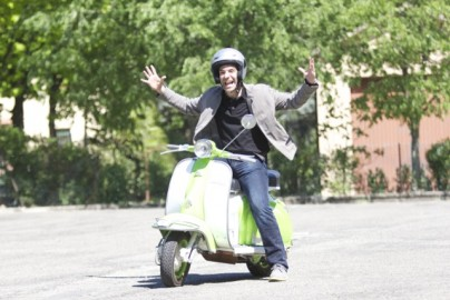 Harper rides a vintage Lambretta scooter — unsuccessfully.